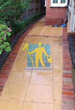 outdoor sandstone tiles pavers wet from cleaning with quarry tiles around Gold Coast