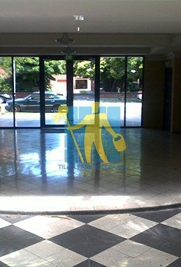 terrazzo tiles building entrance empty before cleaning dirty shadow